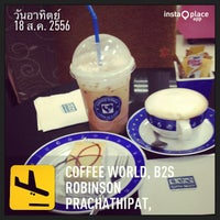 Photo taken at Coffee World by Kanzai Y. on 8/18/2013