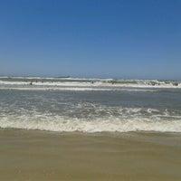 Photo taken at Praia de Imbé by Carina O. on 12/30/2012