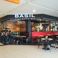 Photo taken at Basil Thai Nudle Bar by Jazzy on 2/28/2013