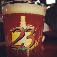 Photo taken at 23rd Street Brewery by Laura K. on 11/24/2012
