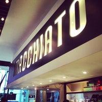 Photo taken at Macchiato Espresso Bar by Greg B. on 5/23/2013