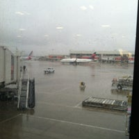 Photo taken at Gate A6 by Alison H. on 3/11/2013