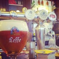 Photo taken at Leuven Belgian Beer Cafe by Craig C. on 12/11/2012