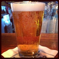 Photo taken at The Lodge Beer and Growler Bar by Janet C. on 8/24/2013