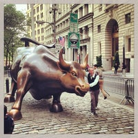 Photo taken at Charging Bull by Arturo Di Modica by Victor G. on 5/15/2013