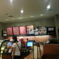 Photo taken at Starbucks Coffee by Maggie R. on 12/19/2012