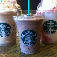 Photo taken at Starbucks by nicolette s. on 7/27/2013
