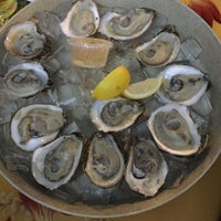 Photo taken at Bunky's Raw Bar & Seafood Grille by Taylor M. on 12/28/2014
