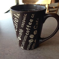 Photo taken at Coffee and All That Jazz by Elaine O. on 5/10/2014