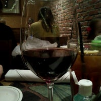 Photo taken at Carrabba's Italian Grill by Jesse S. on 12/18/2011