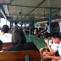 Photo taken at Tak Sin Pier by Korkiat K. on 10/29/2012