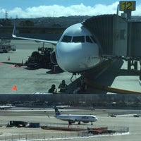 Photo taken at Gate A12 by Adrian L. on 3/24/2016