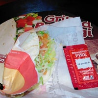Photo taken at Taco Bell by Pochi ぽ. on 12/31/2012