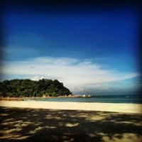 Photo taken at Pantai Teluk Cempedak (Beach) by Syahlihin R. on 11/4/2012