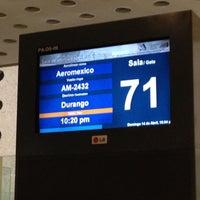 Photo taken at Sala/Gate 71 by Sergio C. on 4/15/2013