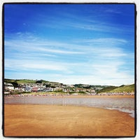Photo taken at Woolacombe Beach by Rob M. on 8/8/2013