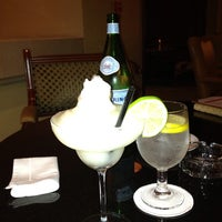 Photo taken at The Library Bar & Cigar Lounge at Four Seasons Hotel Doha by Astrid B. on 6/27/2013