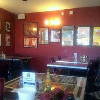 Photo taken at Southside Flying Pizza by Claudia G. on 12/21/2012