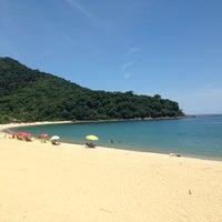 Photo taken at Praia de Boiçucanga by Heitor P. on 2/14/2013