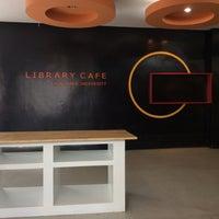 Photo taken at Library Café by Jidapa P. on 8/10/2015