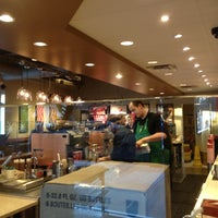 Photo taken at Starbucks by Tina B. on 12/13/2012