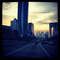 Photo taken at Jalan Tol Dalam Kota by Jerome M. on 7/27/2013