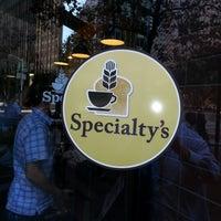 Photo taken at Specialty's Café & Bakery by Richard V. on 10/1/2012