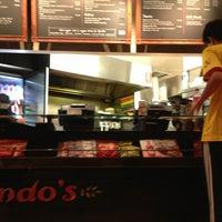 Photo taken at Nando's by Alx on 2/17/2013