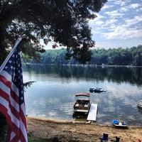 Photo taken at Huzzy Lake by Sarah B. on 7/5/2013