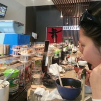 Photo taken at Sushi Train by Chattana S. on 10/7/2012