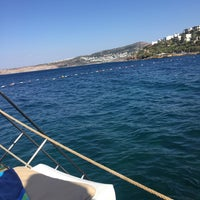 Photo taken at Kırmızı Değirmen Beach by Burcu Y. on 7/8/2016