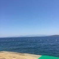 Photo taken at Kırmızı Değirmen Beach by Burcu Y. on 7/6/2016