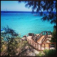 Photo taken at Konnos Beach by Eliophotos E. on 5/25/2013