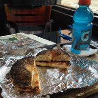 Photo taken at 14th Street Pizza Bagel Cafe by Mike C. on 6/30/2014