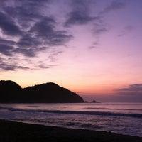 Photo taken at Praia Vermelha do Centro by Thiago P. on 4/28/2013