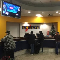 Photo taken at Dollar Rent A Car by Chris O. on 12/21/2015