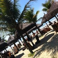 Photo taken at Praia do Sesc Bertioga by Mauricio O. on 10/1/2012