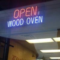 Photo taken at Dino's Wood Burning Pizza by Mehvish M. on 8/31/2014