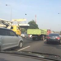 Photo taken at Jalan Tol Lingkar Luar Jakarta Seksi E1 (JORR E1) by KIKIBAGUS ™. on 8/6/2015