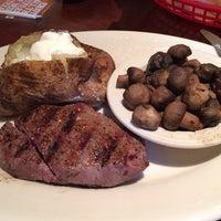 Photo taken at Texas Steakhouse & Saloon by Craig W. on 10/6/2013