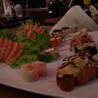 Photo taken at Hanbai Sushi Bar by Paulinho R. on 3/21/2013