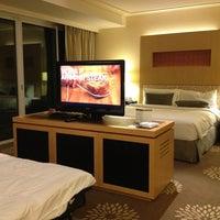 Photo taken at Marina Bay Sands Hotel by Yardarkan U. on 3/19/2013
