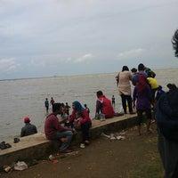 Photo taken at Wisata Pantai Boom Tuban by amien f. on 1/1/2014