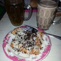 Photo taken at Cafe Sedap Malam by Yustiana T. on 3/13/2014