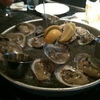 Photo taken at Pappadeaux Seafood Kitchen by Jihan K. on 12/19/2012