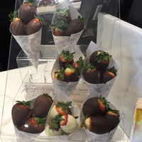 Photo taken at Godiva Chocolatier by Julianne K. on 12/29/2014