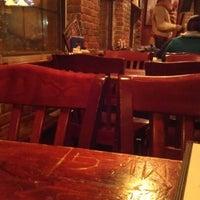 Photo taken at Strange Brew Tavern by Michael O. on 12/13/2012