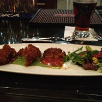 Photo taken at Mango Shiva Indian Bistro & Chai Bar by Luke G. on 11/25/2012