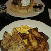 Photo taken at MangoSeed Restaurant by Christina C. on 3/24/2013