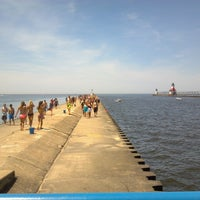 Photo taken at St. Joseph South Pier (at Silver Beach) by Buzz S. on 5/31/2014